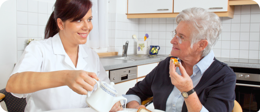 nurse and old woman eating