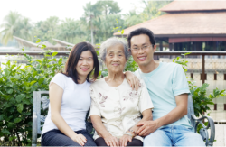 old woman sitting ion between two young adults